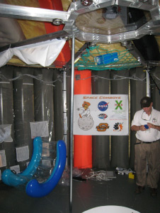 The OSU loft is outfitted with working areas, chairs, and sleeping areas. Photo credit: NASA