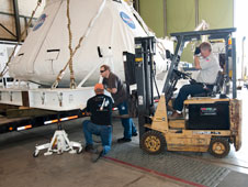 Crews prepared the PA-1 crew module for transport to Kennedy Space Center, Fla., where it will be displayed at the launch of the final space shuttle mission.