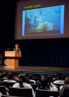 NASA Dryden aerospace engineer Maria Caballero speaks to middle schools students.