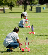 Students participating in the Summer of Innovation Academy set up their pressurized water-bottle rockets.
