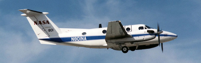 NASA's B200 King Air that carries the AMS thermal-infrared scanner climbs out after takeoff from Edwards Air Force Base.