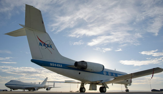 With one of NASA's modified Boeing 747 Shuttle Carrier Aircraft in the background, soon-to-be-retired Shuttle Training Aircraft NASA 944 is parked on the ramp at NASA's Dryden Flight Research Center following its arrival on Aug. 19.