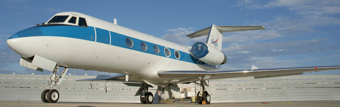 NASA 944, one of four Gulfstream II Shuttle Training Aircraft, is illuminated by the morning sun on the parking ramp at NASA Dryden