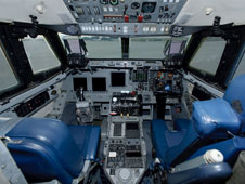 The left-hand controls and instruments in the modified G-II Shuttle Training Aircraft duplicate the flight deck of the space shuttles, while the right-hand position retains the controls and instrumentation of the original G-II flight deck.