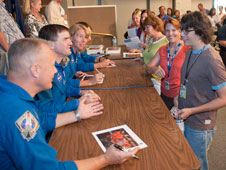 From left, NASA astronauts Doug Hurley, Rex Walheim, Sandra Magnus and Chris Ferguson (partially hidden) found a ready audience of autograph seekers among NASA Dryden employees who attended their briefing on the STS-135 mission on space shuttle Atlantis Aug. 23.