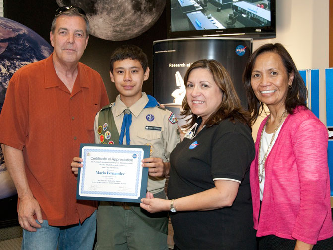 Mayor Ledford of Palmdale and NASA Dryden officials Cecilia Cordova and Gwen Young presented a certificate of appreciation to Fernandez for his work with the shuttle simulator.