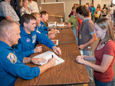 The STS-135 crew signs autographs for an admiring group of Dryden employees.