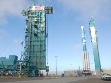 The AJ10 engine for the second stage of a United Launch Alliance Delta II rocket is hoisted.