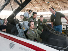 A software-development team prepares for a flight with a new research tool. In the aircraft, from left, are Ryan McMahon and David Marten. Outside the cockpit, from left, are Katherine Ryan, an unidentified technician, Gianmarco Di Loreto, Jade Lemery and Bruce Cogan.