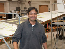 Arun Mangalam, Tao Systems president, is working on several Dryden projects, including one involving the G-III aircraft behind him.