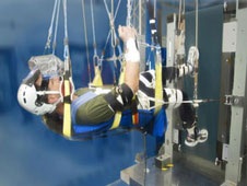 A test subject runs in a zero gravity simulator on Earth in the Exercise Countermeasures Laboratory at Glenn Research Center, Cleveland.