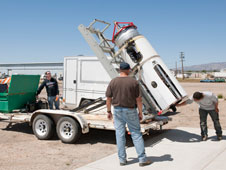 The Tom Tschida photo shows the Masten staff preparing their rocket for transport to their test site.