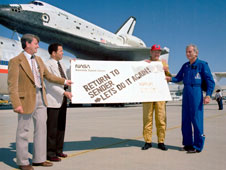 From left, Dryden orbital flight test program manager Melvin Burke, then-Dryden Center Director Isaac Ike Gillam, pilot Fitz Fulton and JSC orbital flight test program manager Donald Deke Slayton give Columbia a humorous sendoff before its ferry flight back to Florida.