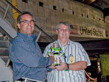 Dryden Center Director David McBride, left, and Dryden space shuttle operations project manager George Grimshaw welcomed Buzz Lightyear back to Earth at Dryden. Buzz flew back Sept. 11, 2009, on Discovery after a nine-month stay on the International Space Station.