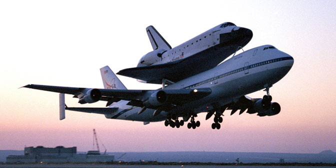 Endeavour, mounted securely atop one of NASA's modified Boeing 747 Shuttle Carrier Aircraft, leaves Dryden at sunrise for Kennedy Space Center