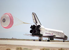 Endeavour's maiden voyage concluded at Edwards with the first deployment of a drag chute on landing.