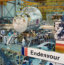 Endeavour's crew module is prepared for assembly at the then Rockwell International facilities at Air Force Plant 42 in Palmdale.