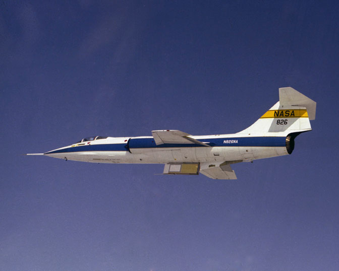 NASA F-104G No. 826 carried shuttle thermal protection system materials on the sides of an underbelly pylon. The flights exposed the materials to greater aerodynamic loads than would be encountered during a shuttle launch.