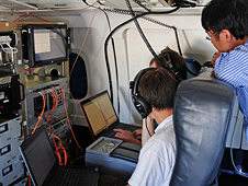 IceBridge team members calibrate the Multichannel Coherent Radar Depth Sounder (MCoRDS)