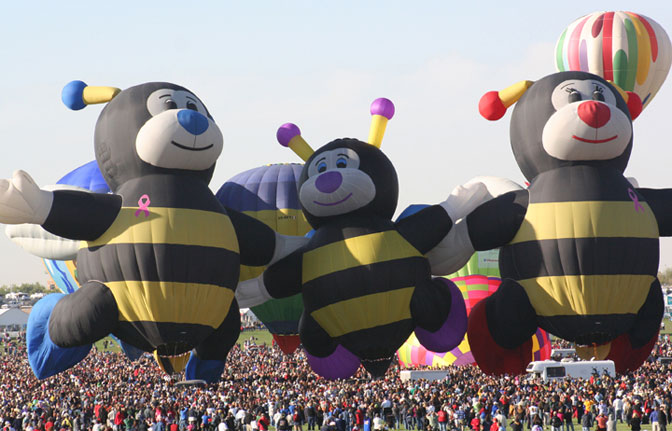 The Bee balloons begin rising during a mass ascension at the Albuquerque International Balloon Fiesta. At the 40th annual event, Dryden led an agency exhibit focused on aeronautics.