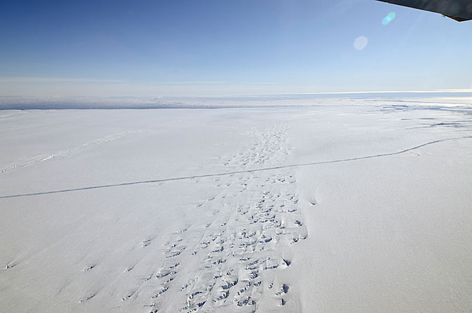 A large, miles-long crack was plainly visible across the ice shelf on the Pine Island Glacier during an overflight by NASA's DC-8 airborne science laboratory during an Operation IceBridge flight Oct. 14.