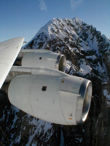 Jagged rocks and precipitous snow banks were just outside as NASA's DC-8 flying laboratory crested a mountain range during a low-level science flight over the Antarctic Peninsula Nov. 16.