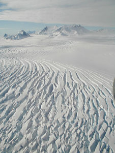The serrated surface of this glacier gives evidence of glacial movement is this view from NASAs DC-8 airborne science laboratory during one of the final flights in the Fall 2011 IceBridge campaign
