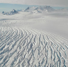 The serrated surface of this glacier gives evidence of glacial movement is this view from NASAs DC-8 airborne science laboratory during one of the final flights in the fall 2011 IceBridge campaign.