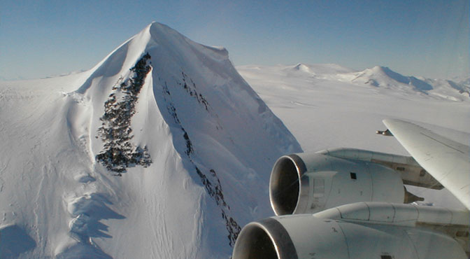 Near-vertical peaks and pinnacles often rose higher than NASAs DC-8 flying laboratory during low-level data-gathering flights in the Operation IceBridge campaign.
