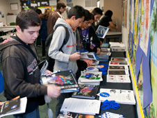 Discovery Academy students eagerly grabbed a wealth of NASA educational and promotional materials during the science, technology, engineering and mathematics event.