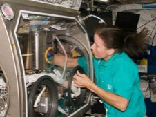 NASA astronaut Shannon Walker, Expedition 24 flight engineer, works with the Smoke Aerosol Measurement Experiment.