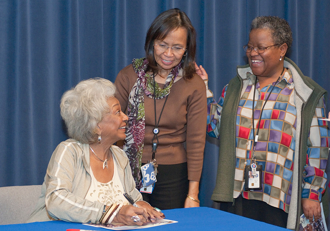 Actress Nichelle Nichols, who portrayed Lt. Uhura in the original Star Trek TV series, signed autographs.