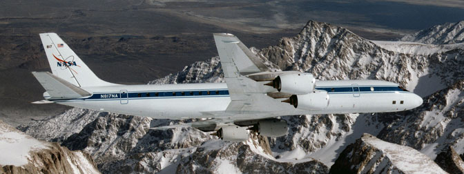 NASAs DC-8 airborne science laboratory soars over the Pinnacles near Mt. Whitney, Calif., during a checkout flight in the winter of 1998.
