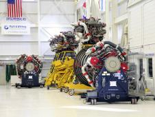 RS 25D engines line the wall of the Engine Processing Facility at Kennedy Space Center, Fla.