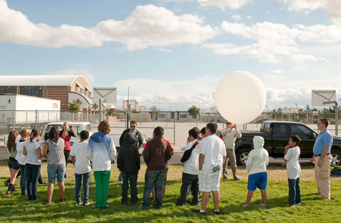 Students involved with the NASA STARS program work on projects, like launching a weather experiment, to use the skills they are developing in class and learn about professional careers where those skills are used.