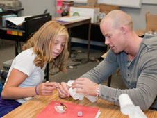 Brian Griffin works with Mackenzie Denzin on a hands-on project.