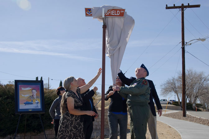 Air Force Flight Test Center commander Brig. Gen. Robert Nolan and other base officials unveil the Crossfield Drive street sign in honor of the late NACA research test pilot Scott Crossfield Jan. 18.