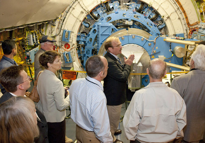 Bob Meyer, program manager of NASA's Stratospheric Observatory for Infrared Astronomy, highlights some of the technical features of the German-built infrared telescope mounted inside the SOFIA 747SP.