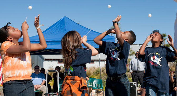 Four students tested their talent at balancing a ping-pong ball atop a stream of air blown through a straw during the BEST curriculum kickoff event for the Los Angeles Unified School District's Beyond the Bell after-school program.