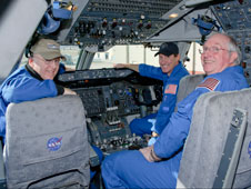 Jeff Moultrie, Bob Zimmerman and Henry Taylor, (left to right) of Johnson Space Center's Aircraft Operations Directorate took a brief moment for the photographer in the flight deck of NASA Shuttle Carrier Aircraft 911 after crewing its final flight