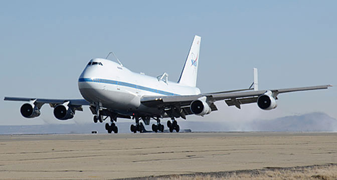 NASA 911, one of two modified Boeing 747s that were modified for use as Shuttle Carrier Aircraft for the space shuttles, lands at Air Force Plant 42 in Palmdale Feb. 8 after its final flight