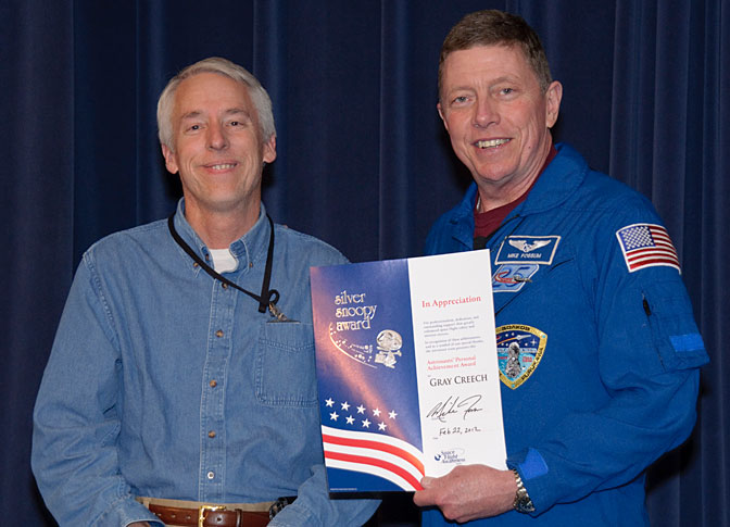 Dryden public affairs specialist Gray Creech of Tybrin Corp. was presented a Silver Snoopy Award by NASA astronaut Mike Fossum for his support of the Space Shuttle Program.