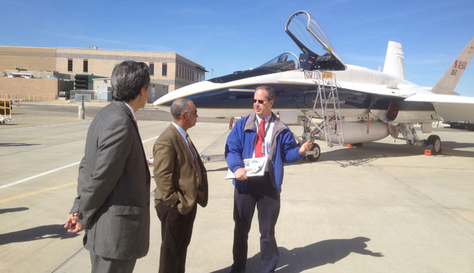 NASA administrator Charlie Bolden accompanied by NASA Dryden center director David McBride is briefed on sonic boom reduction and mitigation research by supersonics engineer Ed Haering.