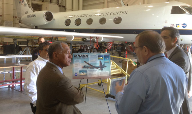 NASA administrator Bolden is briefed on science mission operations by Randy Albertson, NASA Airborne Science deputy program director.