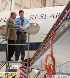 NASA administrator Charlie Bolden is briefed on research instrumentation installation on NASA Dryden's Gulfstream III aeronautics test bed by project manager Tom Rigney.