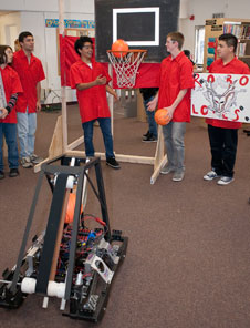 AVHS Robolopes team members demonstrate how their robot can sink a shot through the hoop during rollout ceremonies.