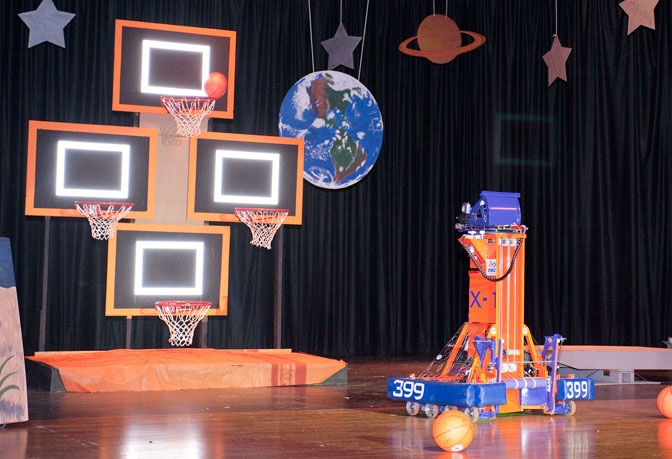 Lancaster High Eagle Robotics Team's 2012 FIRST competition robot, nicknamed X-1, demonstrated its prowess at shooting a basketball into one of four hoops during rollout ceremonies on stage Feb. 17.