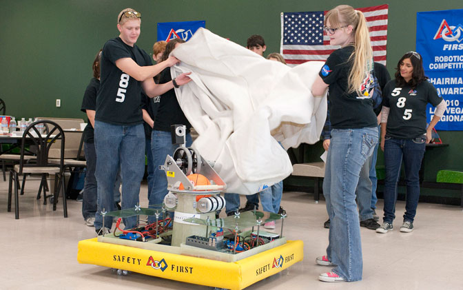 Brother and sister Andrew and Alexis Bartels unveil the Tehachapi High Cyber Penguins 2012 robot during rollout Feb. 18.