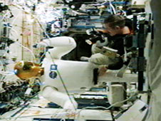 Commander Dan Burbank and Robonaut 2