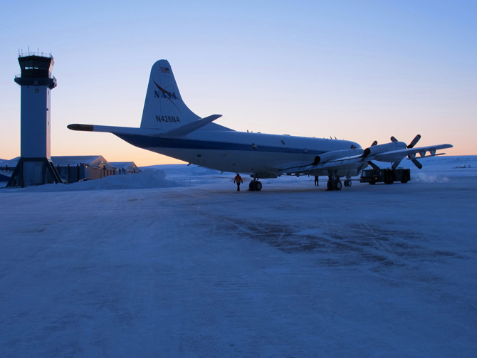 NASA's P-3B is pulled from the hanger onto the frozen runway at Thule, Greenland.